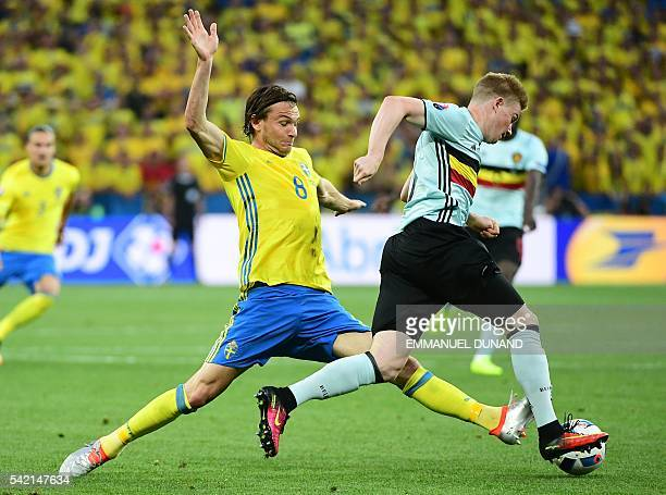 TOPSHOT Sweden's midfielder Albin Ekdal vies with Belgium's midfielder Kevin De Bruyne during the Euro 2016 group E football match between Sweden and...