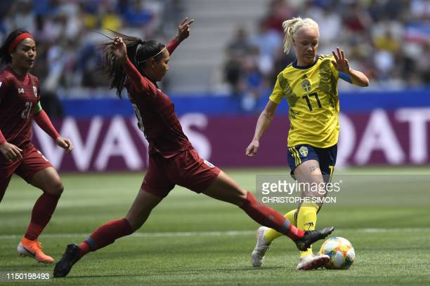 TOPSHOT Sweden's midfielder Caroline Seger vies with Thailand's forward Taneekarn Dangda during the France 2019 Women's World Cup Group F football...
