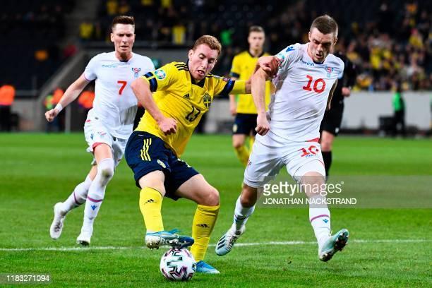 Sweden's midfielder Dejan Kulusevski and Faroes' midfielder Solvi Vatnhamar vie for the ball during the UEFA Euro 2020 Group F qualification football...