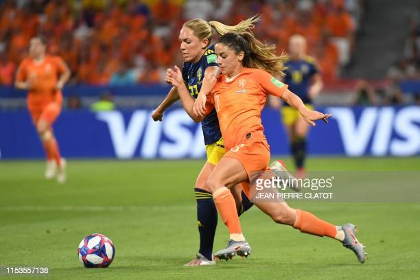 Sweden's midfielder Elin Rubensson vies with Sweden's forward Sofia Jakobsson during the France 2019 Women's World Cup semi-final football match...