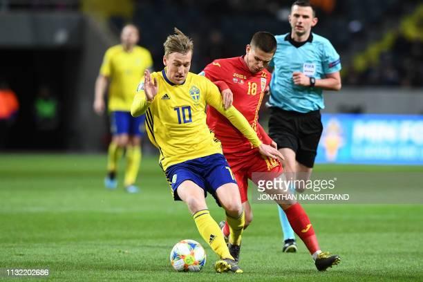 Sweden's midfielder Emil Forsberg and Romania's midfielder Razvan Marin vie for the ball during the Euro 2020 football 1st round Groupe F...