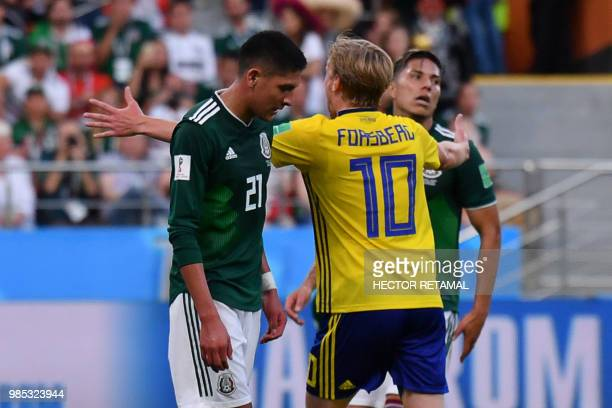 TOPSHOT Sweden's midfielder Emil Forsberg celebrates after Mexico's defender Edson Alvarez scored an own goal for 03 during the Russia 2018 World Cup...