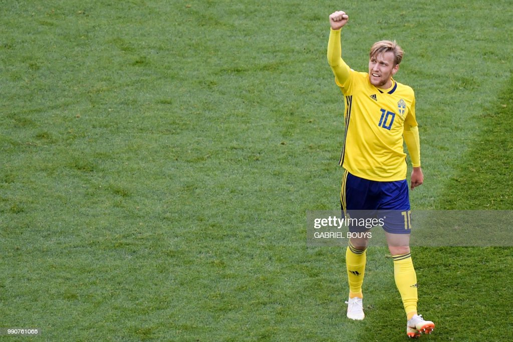 Sweden's midfielder Emil Forsberg celebrates after scoring during the Russia 2018 World Cup round of 16 football match between Sweden and Switzerland at the Saint Petersburg Stadium in Saint Petersburg on July 3, 2018. (Photo by GABRIEL BOUYS / AFP) / RESTRICTED