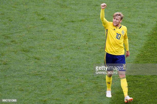 Sweden's midfielder Emil Forsberg celebrates after scoring during the Russia 2018 World Cup round of 16 football match between Sweden and Switzerland...