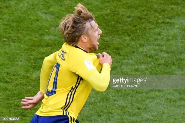TOPSHOT Sweden's midfielder Emil Forsberg celebrates after scoring during the Russia 2018 World Cup round of 16 football match between Sweden and...