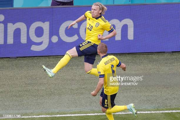Sweden's midfielder Emil Forsberg celebrates after scoring his team's first goal during the UEFA EURO 2020 Group E football match between Sweden and...