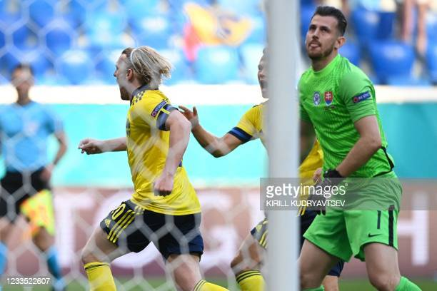 Sweden's midfielder Emil Forsberg celebrates past Slovakia's goalkeeper Martin Dubravka after scoring a goal during the UEFA EURO 2020 Group E...