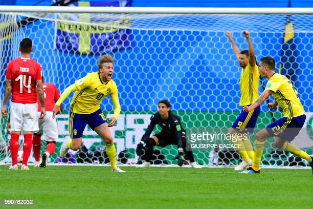 TOPSHOT Sweden's midfielder Emil Forsberg celebrates scoring during the Russia 2018 World Cup round of 16 football match between Sweden and...