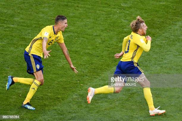 TOPSHOT Sweden's midfielder Emil Forsberg celebrates with Sweden's defender Mikael Lustig after scoring during the Russia 2018 World Cup round of 16...