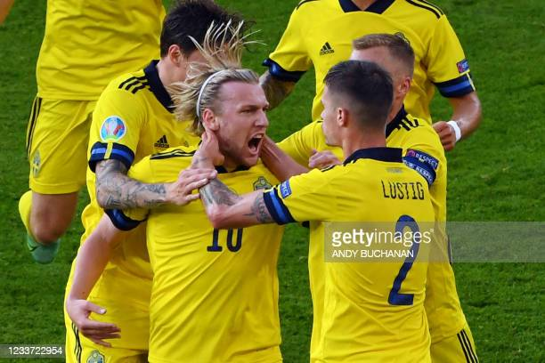 Sweden's midfielder Emil Forsberg celebrates with teammates after scoring his team's first goal during the UEFA EURO 2020 round of 16 football match...
