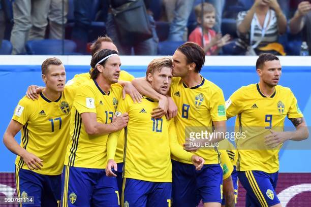 TOPSHOT Sweden's midfielder Emil Forsberg celebrates with teammates after scoring the opener during the Russia 2018 World Cup round of 16 football...