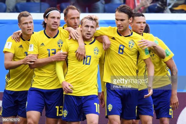 TOPSHOT Sweden's midfielder Emil Forsberg celebrates with teammates Sweden's forward John Guidetti Sweden's midfielder Gustav Svensson and Sweden's...