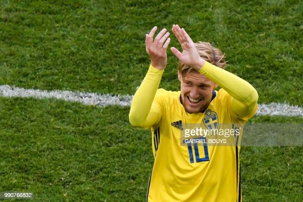 TOPSHOT Sweden's midfielder Emil Forsberg greets fans as he leaves the pitch during the Russia 2018 World Cup round of 16 football match between...
