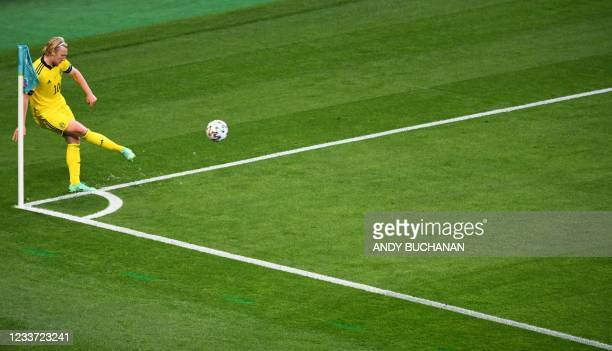 Sweden's midfielder Emil Forsberg hits a corner kick during the UEFA EURO 2020 round of 16 football match between Sweden and Ukraine at Hampden Park...