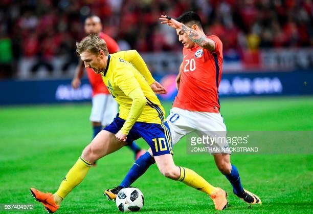 Sweden's midfielder Emil Forsberg vies with Chile's midfielder Charles Aranguiz during the international friendly football match Sweden vs Chile at...