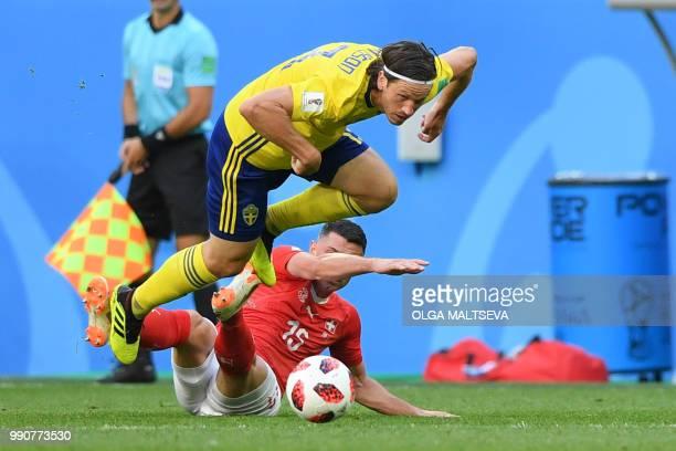 Sweden's midfielder Gustav Svensson fights for the ball with Switzerland's midfielder Blerim Dzemaili during the Russia 2018 World Cup round of 16...