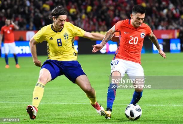 Sweden's midfielder Gustav Svensson vies for the ball with Chile's midfielder Charles Aranguiz during the international friendly football match...
