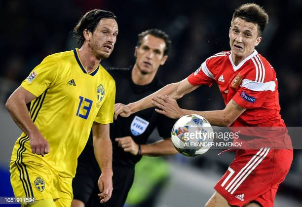 Sweden's midfielder Gustav Svensson vies with Russia's Alexander Golovin during the UEFA Nations League football match between Russia and Sweden at...