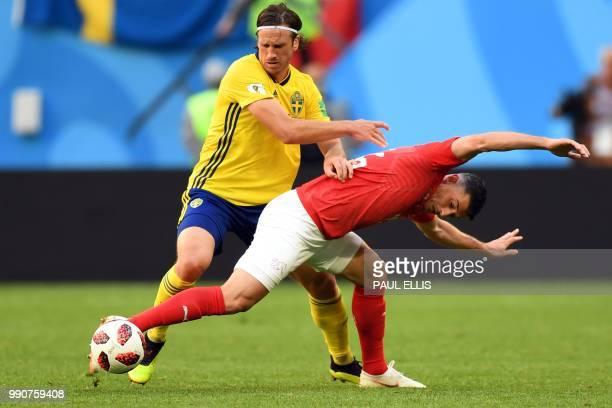Sweden's midfielder Gustav Svensson vies with Switzerland's midfielder Blerim Dzemaili during the Russia 2018 World Cup round of 16 football match...