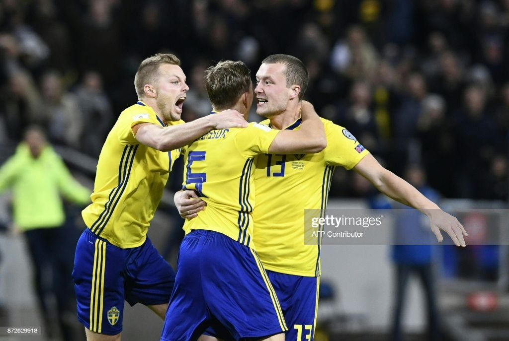 Sweden's midfielder Jakob Johansson (R) celebrates scoring the opening goal with team mates Sweden's midfielder Sweden's midfielder Sebastian Larsson (C) and Sweden's defender Martin Olsson during the FIFA World Cup 2018 qualification football match between Sweden and Italy in Solna,Sweden on November 10, 2017. / AFP PHOTO / Jonathan NACKSTRAND / The erroneous mention[s] appearing in the metadata of this photo by Jonathan NACKSTRAND has been modified in AFP systems in the following manner: [Sebastian Larsson] instead of [Anders Forsberg]. Please immediately remove the erroneous mention[s] from all your online services and delete it (them) from your servers. If you have been authorized by AFP to distribute it (them) to third parties, please ensure that the same actions are carried out by them. Failure to promptly comply with these instructions will entail liability on your part for any continued or post notification usage. Therefore we thank you very much for all your attention and prompt action. We are sorry for the inconvenience this notification may cause and remain at your disposal for any further information you may require.