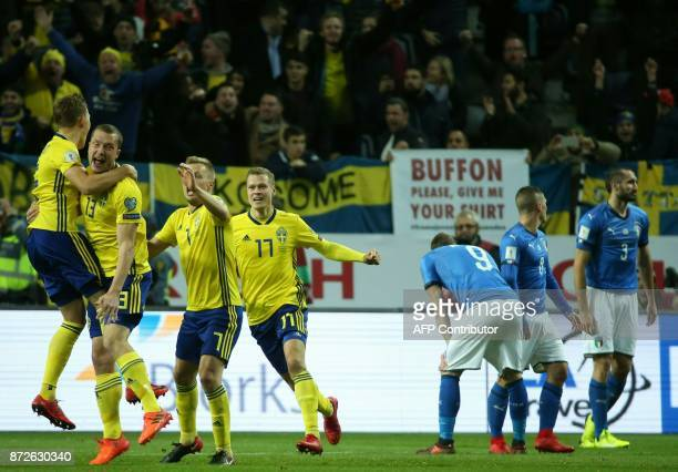 Sweden's midfielder Jakob Johansson celebrates scoring the opening goal with team mates during the FIFA World Cup 2018 qualification football match...