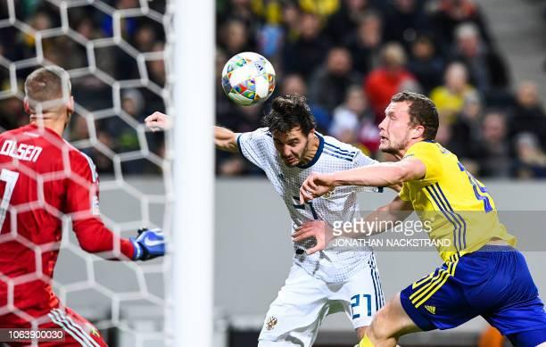Sweden's midfielder Jakob Johansson vies with Russia's midfielder Aleksandr Erokhin during the UEFA Nations League football match between Sweden and...