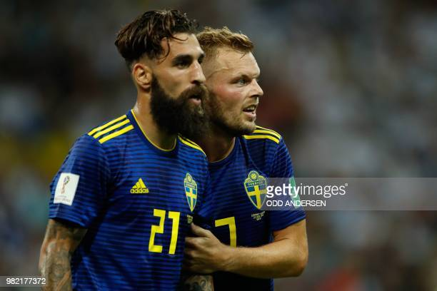 Sweden's midfielder Jimmy Durmaz and Sweden's midfielder Sebastian Larsson react at the end of the Russia 2018 World Cup Group F football match...