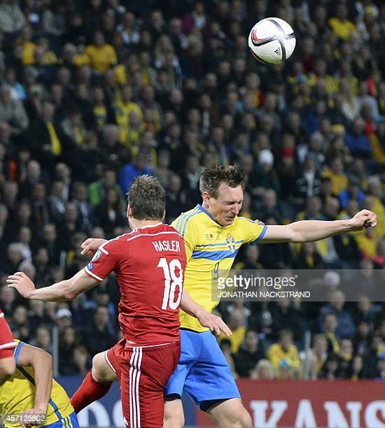 Sweden's midfielder Kim Kallstrom and Liechtenstein's midfielder Nicolas Hasler vie for the ball during the Euro 2016 Group G qualifying football...
