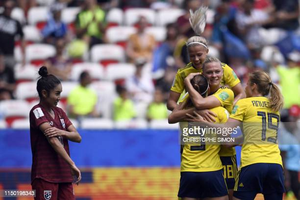 TOPSHOT Sweden's midfielder Kosovare Asllani is congratulated by teammates after scoring a goal during the France 2019 Women's World Cup Group F...