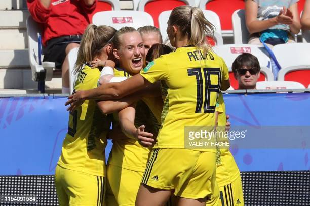 TOPSHOT Sweden's midfielder Kosovare Asllani is congratulated by teammates after scoring a goal during the France 2019 Women's World Cup third place...