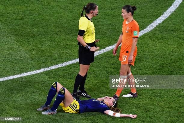 Sweden's midfielder Kosovare Asllani lies on the ground after an injury during the France 2019 Women's World Cup semi-final football match between...