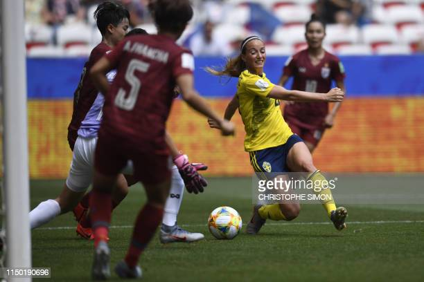 TOPSHOT Sweden's midfielder Kosovare Asllani scores a goal during the France 2019 Women's World Cup Group F football match between Sweden and...