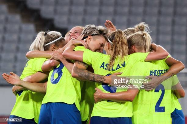 Sweden's midfielder Lina Hurtig celebrates with teammates after she scored the third goal during the Tokyo 2020 Olympic Games women's group G first...