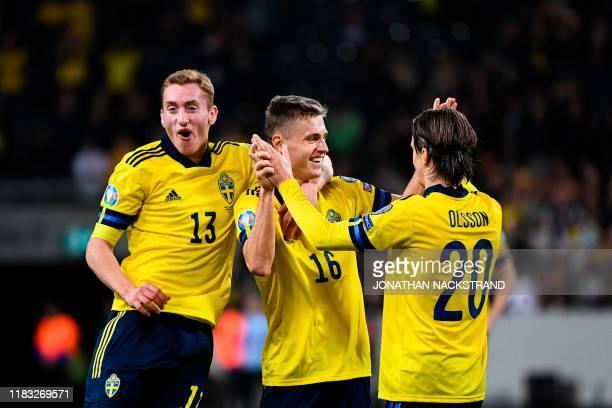 Sweden's midfielder Mattias Svanberg celebrates with his teammates Sweden's midfielder Dejan Kulusevski and Sweden's midfielder Kristoffer Olsson...