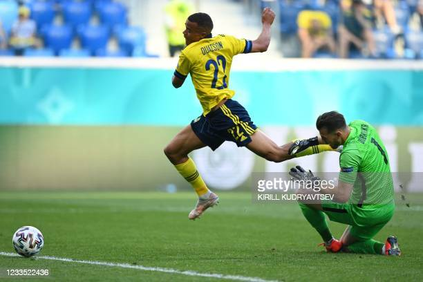 Sweden's midfielder Robin Quaison is fouled by Slovakia's goalkeeper Martin Dubravka during the UEFA EURO 2020 Group E football match between Sweden...