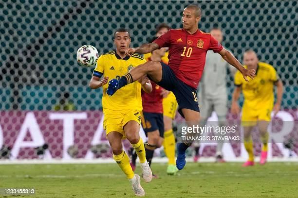 Sweden's midfielder Robin Quaison marks Spain's midfielder Thiago Alcantara during the UEFA EURO 2020 Group E football match between Spain and Sweden...