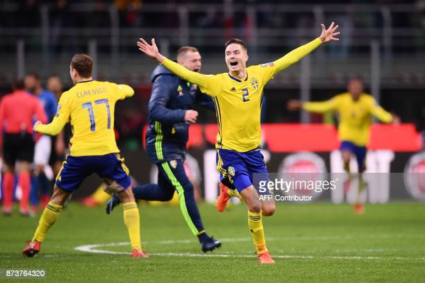 Sweden's midfielder Viktor Claesson and Sweden's defender Mikael Lustig celebrate at the end of the FIFA World Cup 2018 qualification football match...