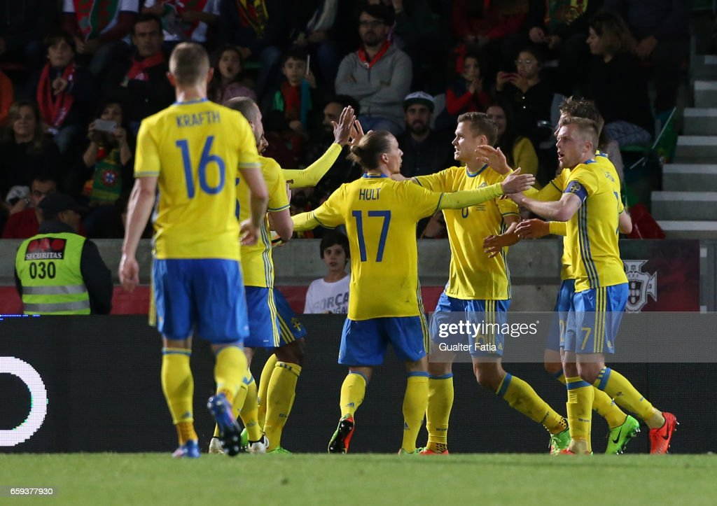 Sweden's midfielder Viktor Claesson celebrates with teammates after scoring a goal during the International Friendly match between Portugal and Sweden at Estadio dos Barreiros on March 28, 2017 in Funchal (Madeira), Portugal.