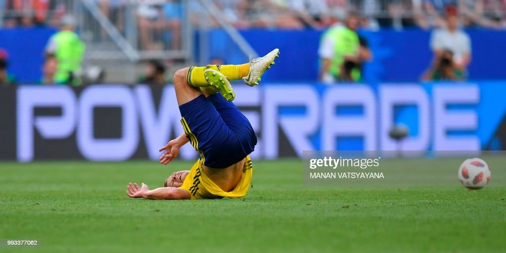 TOPSHOT - Sweden's midfielder Viktor Claesson falls after a challenge during the Russia 2018 World Cup quarter-final football match between Sweden and England at the Samara Arena in Samara on July 7, 2018. (Photo by Manan VATSYAYANA / AFP) / RESTRICTED