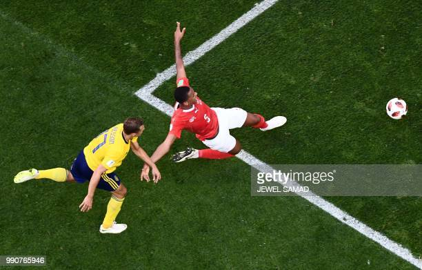 Sweden's midfielder Viktor Claesson vies with Switzerland's defender Manuel Akanji during the Russia 2018 World Cup round of 16 football match...