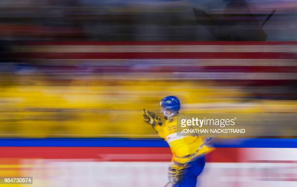 Sweden's Mika Zibanejad celebrates with his teammates after scoring a goal during the 2018 IIHF Men's Ice Hockey World Championship match between...