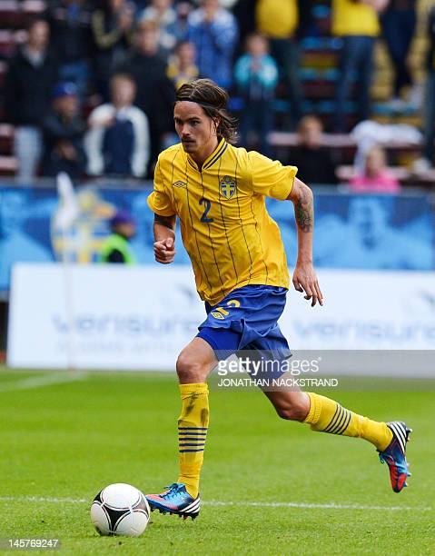 Sweden's Mikael Lustig dribbles during the friendly football match between Sweden and Serbia at the Rasunda Stadium in Stockholm on June 5 2012...