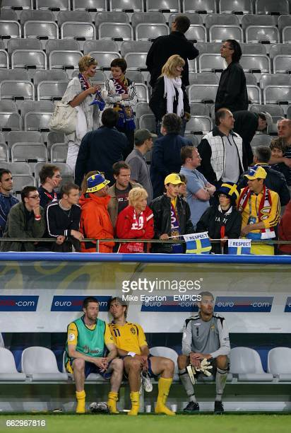 Sweden's Mikael Nilsson Johan Elmander and Andreas Isaksson sits dejected on the bench after the final whistle