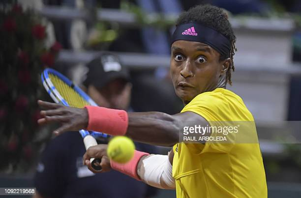 Sweden's Mikael Ymer returns the ball to Colombia's Daniel Galan during the Davis Cup qualifiers at the Sports palace in Bogota on February 1 2019