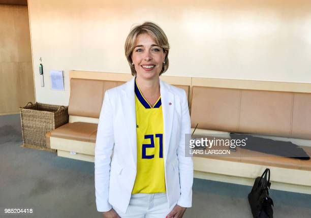 Sweden's Minister for Social Affairs Annika Strandhäll poses as she is dressed in a football jersey with the number of Sweden's national football...
