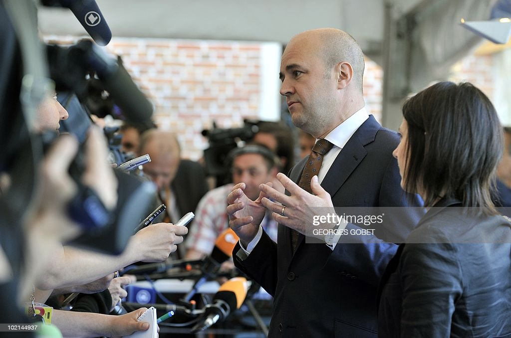 Sweden's Minister of State Fredrik Reinfeldt addresses journalists as he arrives for a statutory Summit of the European People's Party (EPP), on June 16, 2010 in Meise, near Brussels, on the eve of an European Council gathering EU's heads of state. During the one-day meeting, EU leaders are expected to adopt 'Europe 2020', the new strategy for jobs and growth, and will also discuss the forthcoming G 20 summit, economic governance and post-Copenhagen climate strategy.