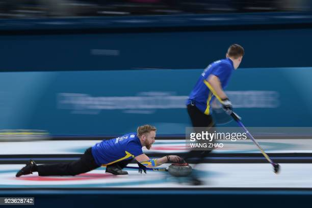 TOPSHOT Sweden's Niklas Edin strows the stone during the curling men's gold medal game between the USA and Sweden during the Pyeongchang 2018 Winter...