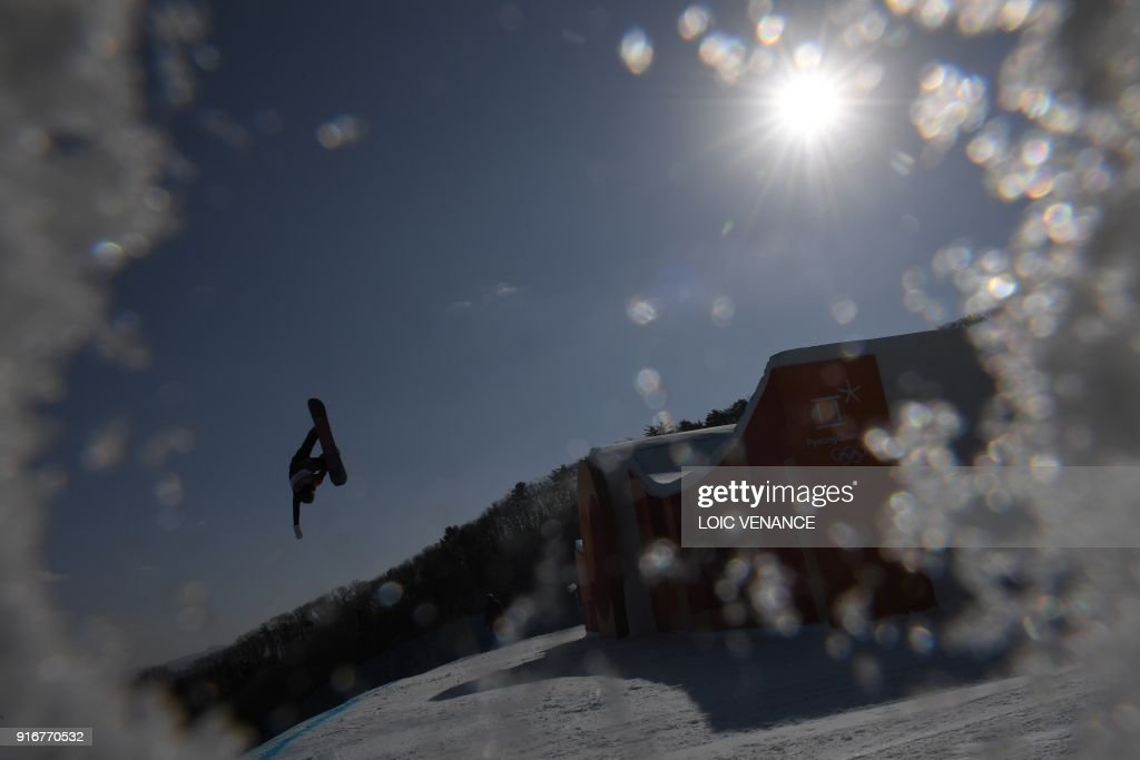 TOPSHOT - Sweden's Niklas Mattsson competes in a run during the final of the men's snowboard slopestyle at the Phoenix Park during the Pyeongchang 2018 Winter Olympic Games on February 11, 2018 in Pyeongchang. /