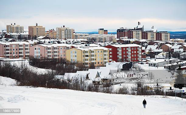 Sweden's northern town Kiruna situated in the province of Lapland is pictured as a man walks through the snow on November 16 2012 AFP PHOTO/JONATHAN...