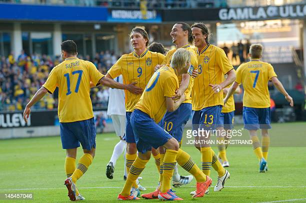 Sweden's Ola Toivonen celebrates with his teammates after scoring a goal during their friendly football match at the Gamla Ullevi Stadium in...
